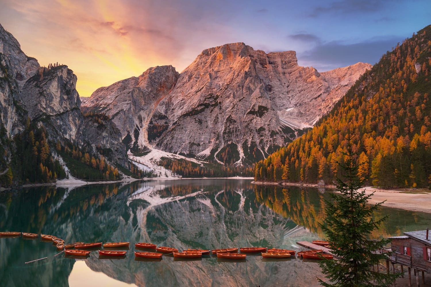 Lago di Braies lake and Seekofel peak at sunrise, Dolomites. Ita